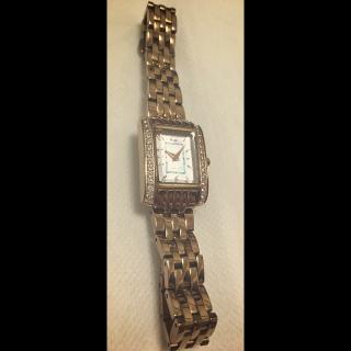 このコーデで使われているcanal4℃の腕時計[ゴールド]
