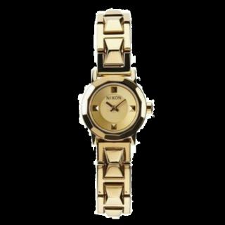 このコーデで使われているNIXONの腕時計[ゴールド]