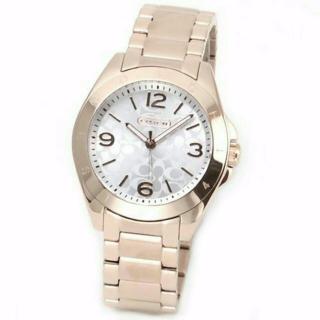 このコーデで使われているCOACHの腕時計[ゴールド]