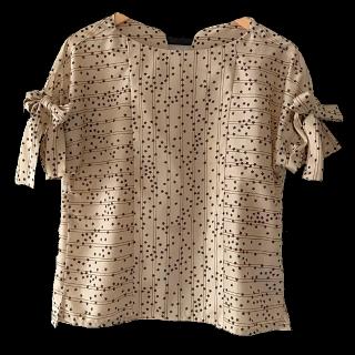 このコーデで使われているdoll up oopsのシャツ/ブラウス[ベージュ]